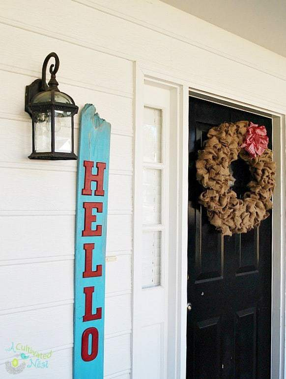 This reclaimed wood Hello sign by A Cultivated Nest is perfect for any front door!