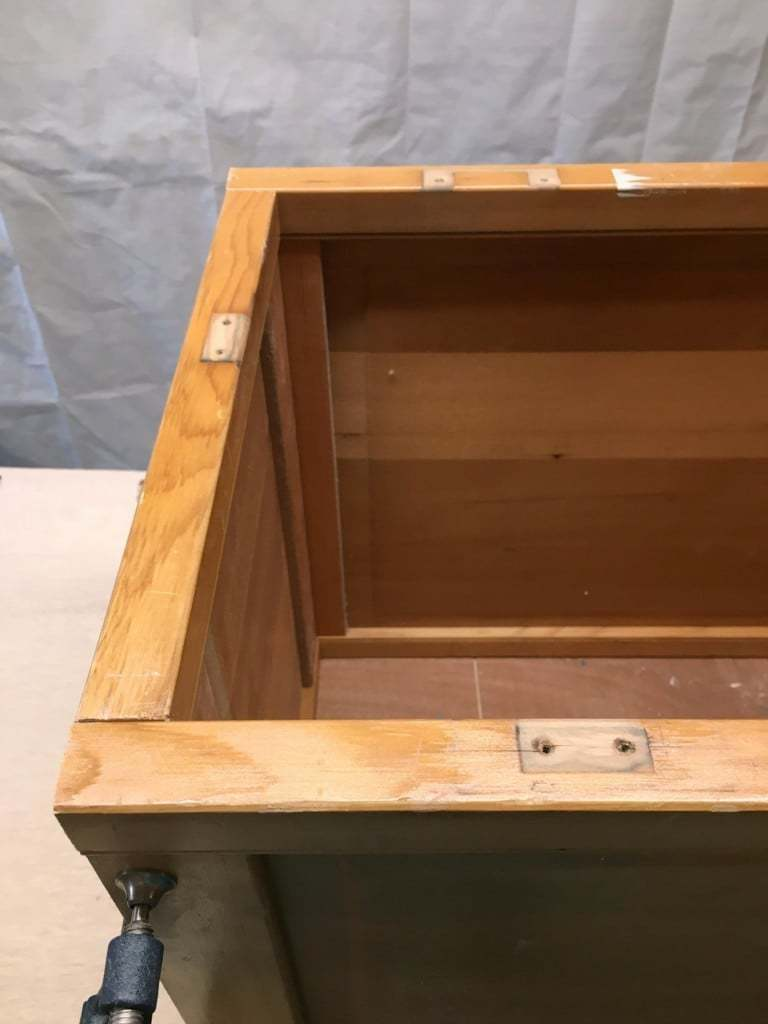 Any holes or damage on the bifold doors should be facing towards the bottom of the blanket box - The Handyman's Daughter