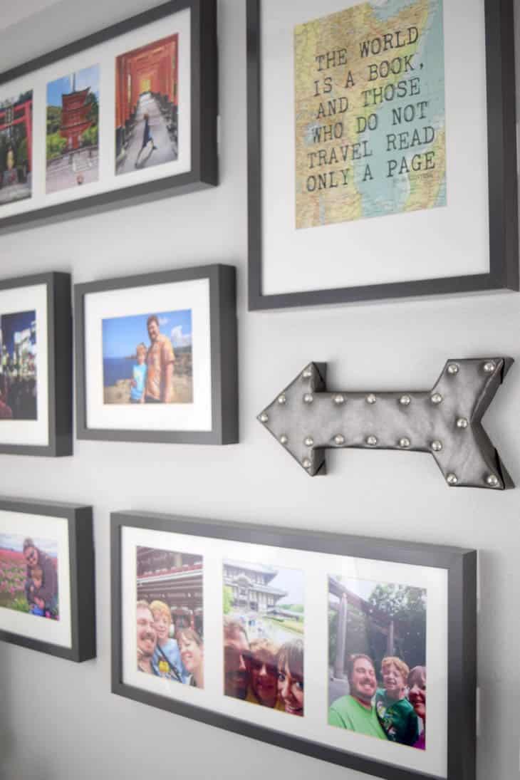 DIY arrow decor hanging on gallery wall