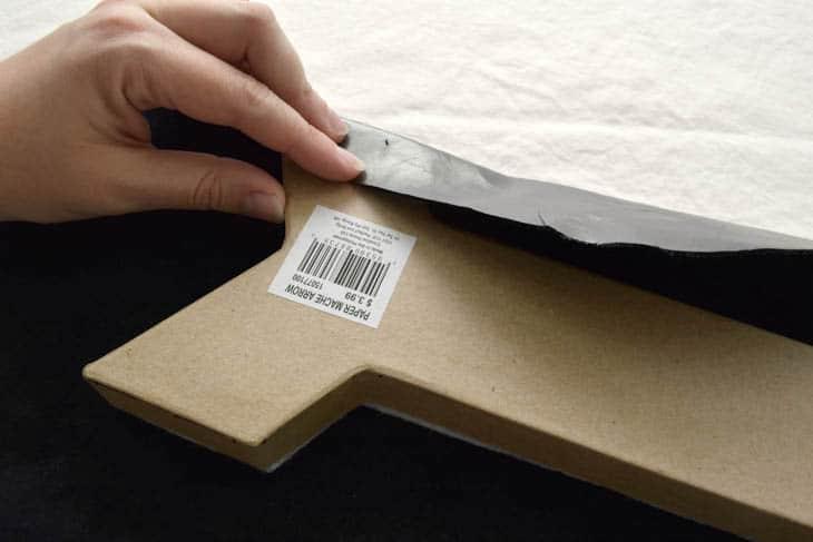 folding leather over cardboard arrow shape