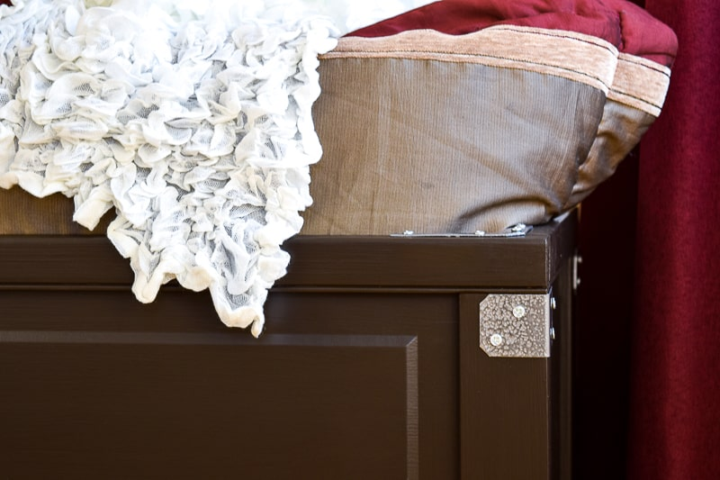 close up view of blanket box with decorative hardware