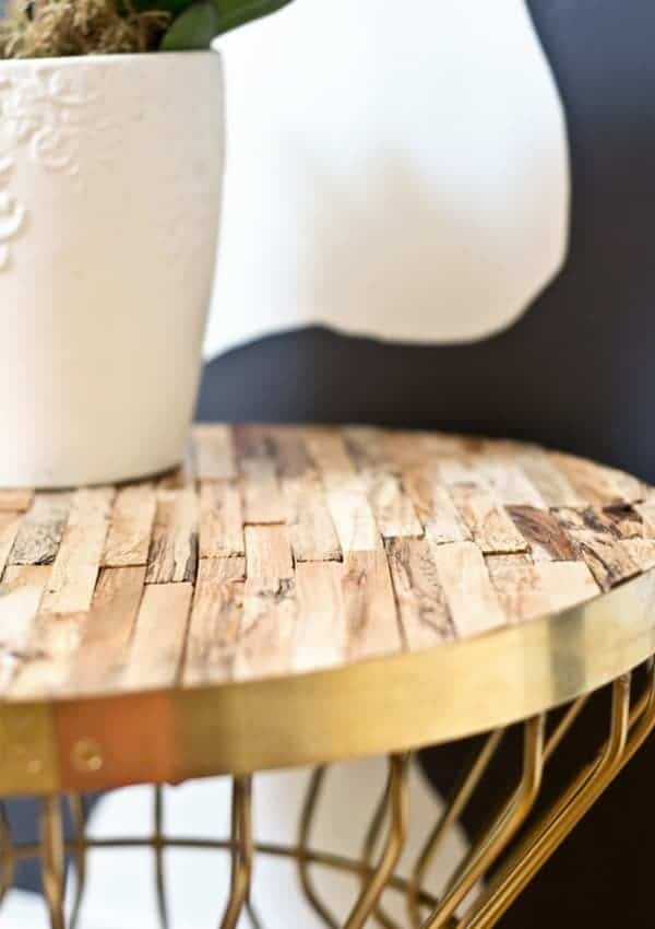 I love how driftwood gives this metal side table warmth and texture!