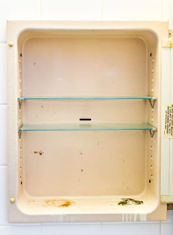 old, rusty metal medicine cabinet