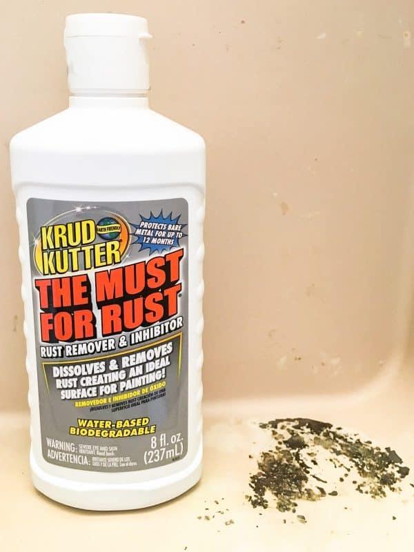 bottle of Krud Kutter inside metal medicine cabinet