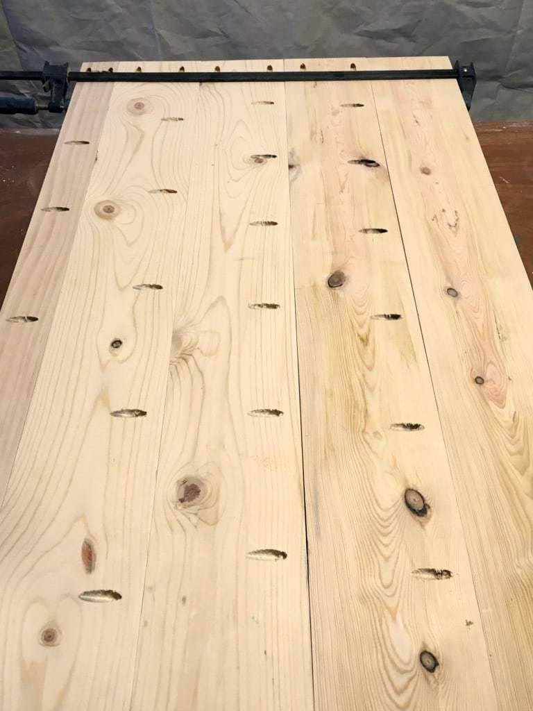To create the planked work surface of this IKEA desk hack, drill pocket holes along the length the boards.