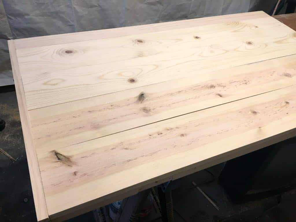 The planked top ties together the two pieces of this IKEA desk hack - The Handyman's Daughter
