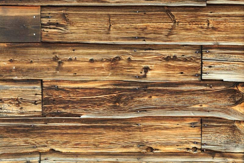 reclaimed wood wall with nail holes