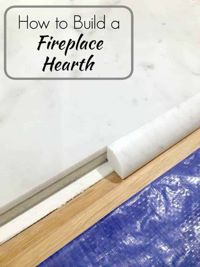 fireplace hearth building in progress with marble tile and quarter round