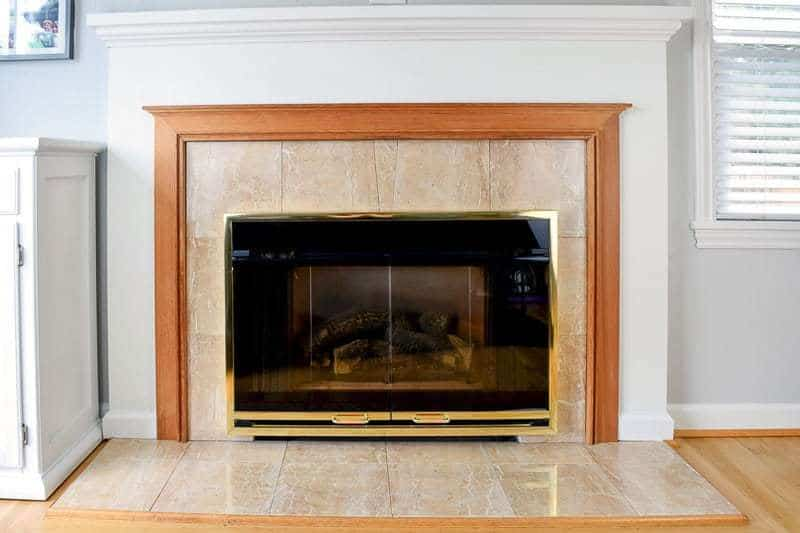 The fireplace surround before was a strange combination of peach marble tile and boring wood trim - The Handyman's Daughter