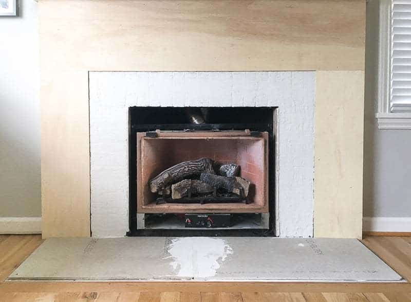 With The Fireplace Surround Clad In Plywood And Brick Covered Thin Set