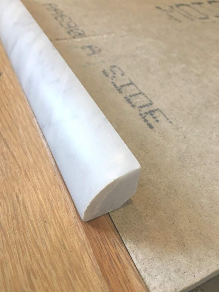 This marble quarter round trim will be perfect for hiding the damaged floor edge - The Handyman's Daughter