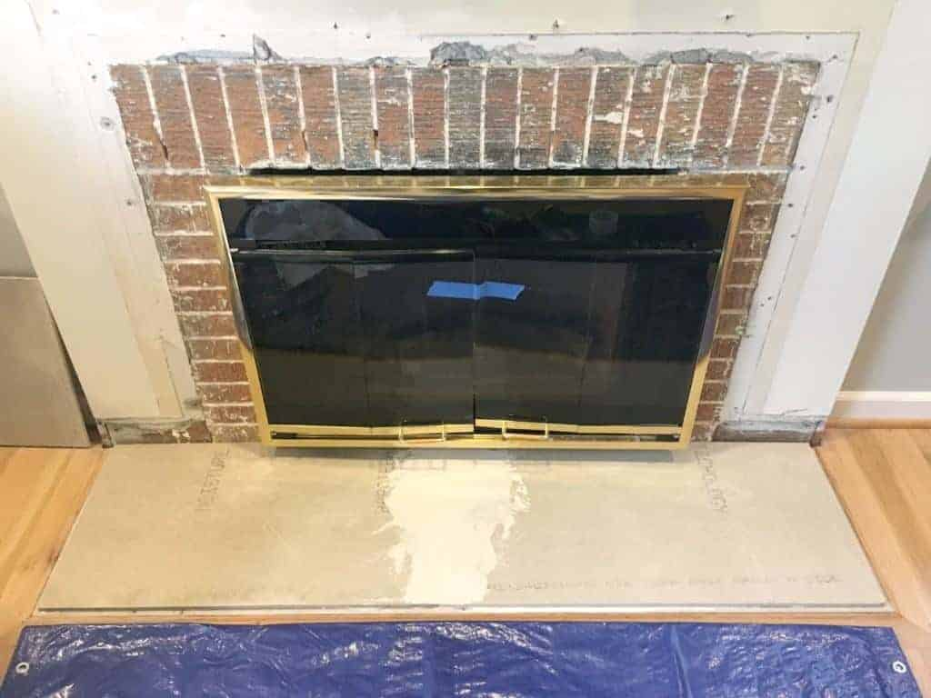 A second layer of backer board was added to give the fireplace hearth a bit of height - The Handyman's Daughter