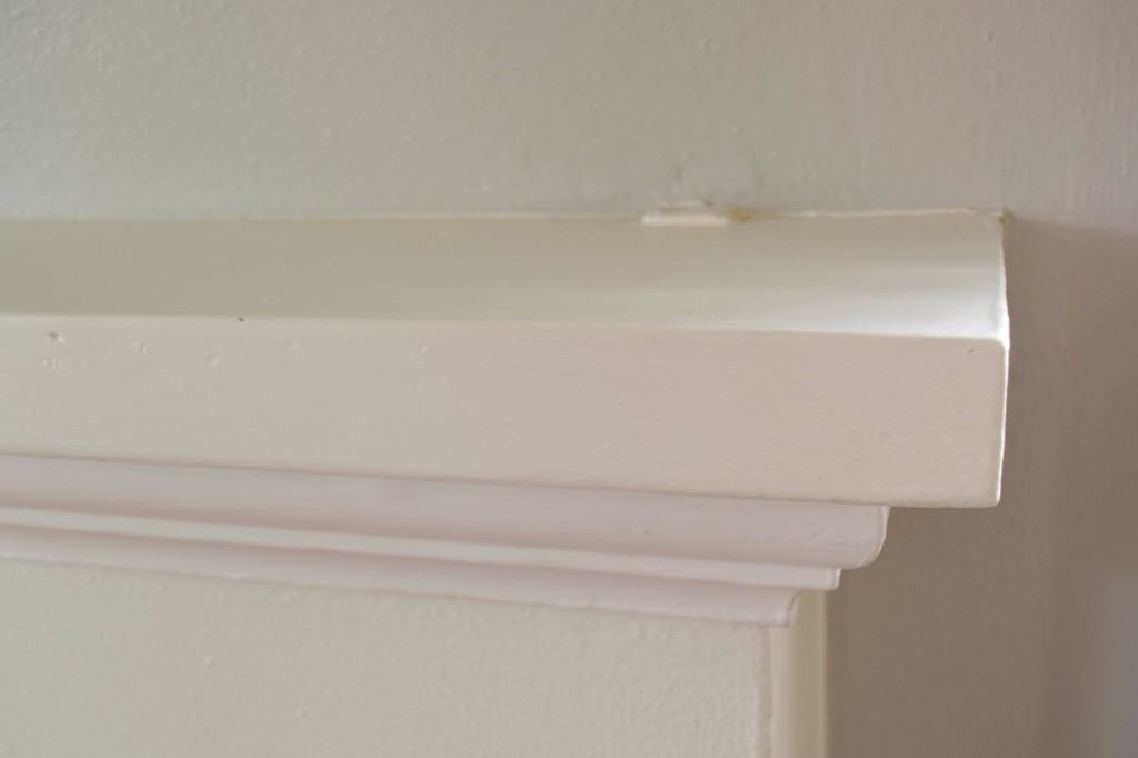 These bumps on the mantel are actually the brackets that are holding it to the wall! - The Handyman's Daughte
