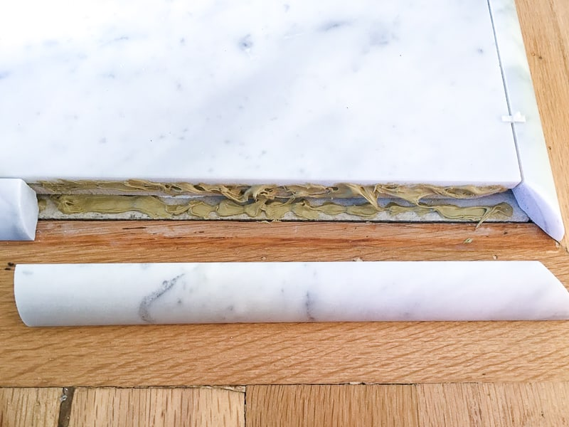 Liquid Nails for marble applied to fireplace hearth quarter round tile