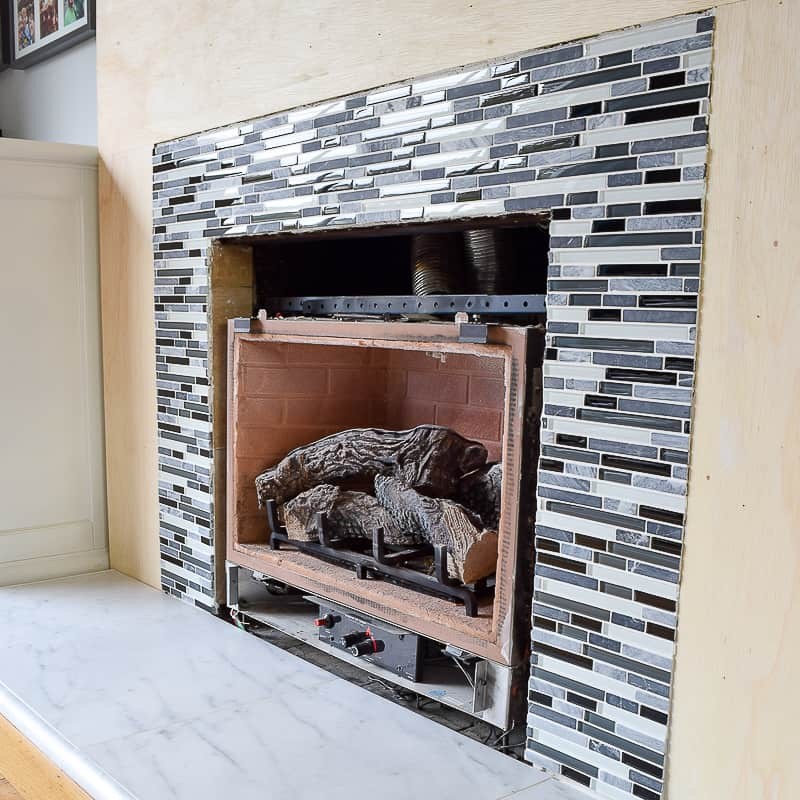How To Tile A Fireplace Even If It S, How To Reface A Brick Fireplace With Tile