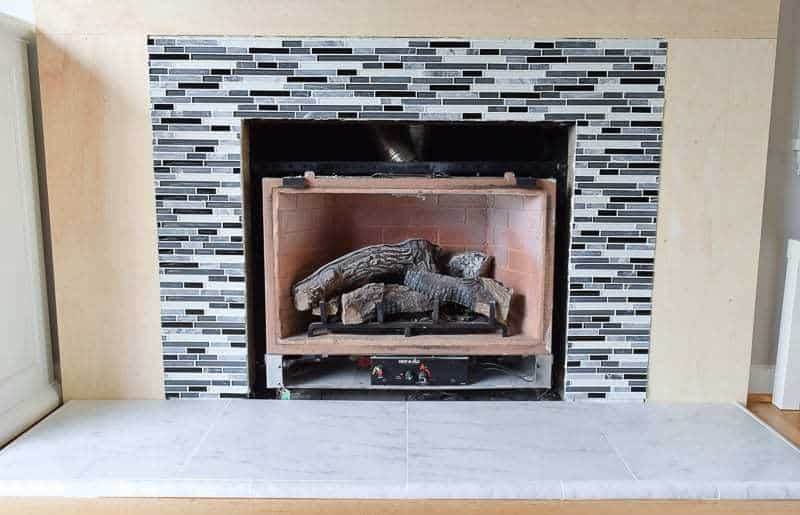 Our fireplace tile is finished! Check out the tutorial to see how I installed it myself.