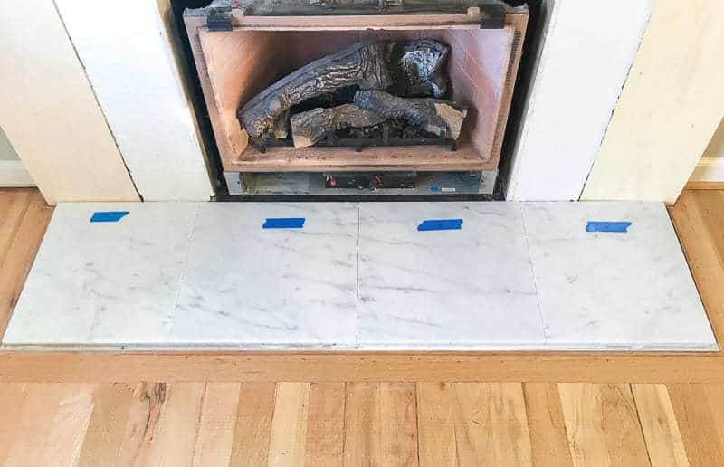 I laid out the fireplace tile so it looked like it was one large slab of marble.