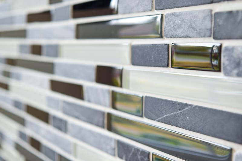 stone and glass fireplace tile