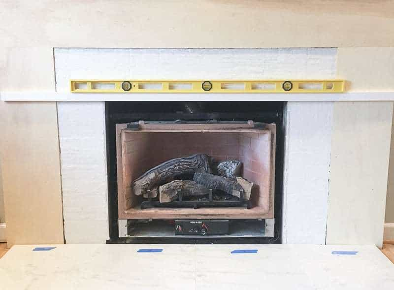 Add a level board to the top edge of the firebox so the fireplace tile doesn't sag in the middle.
