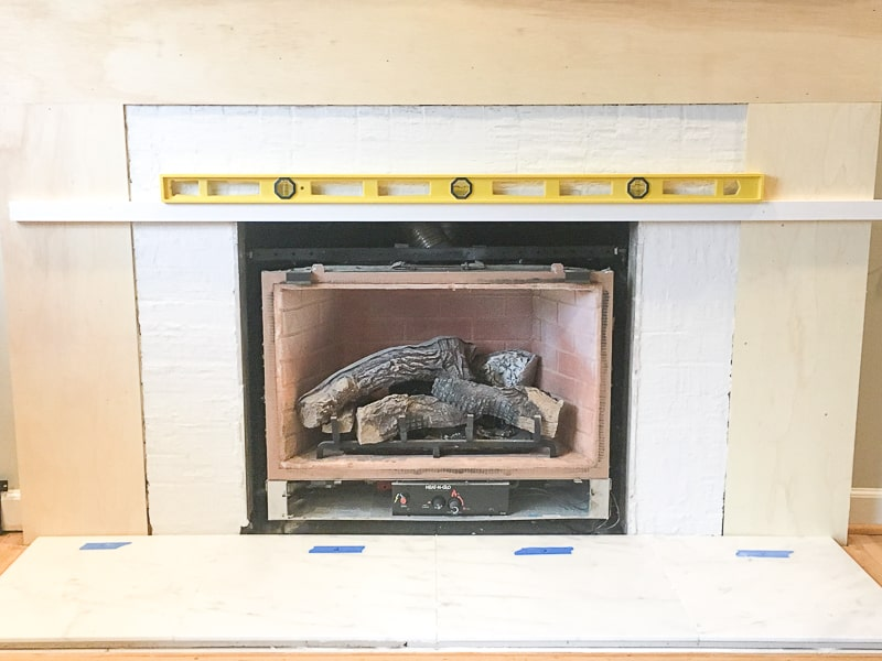 support board across firebox to support fireplace tile