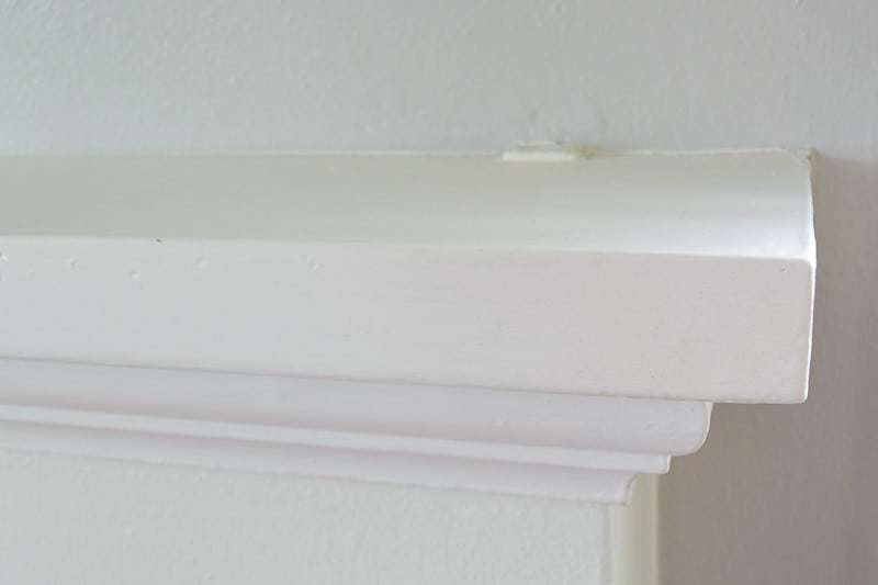 Our old mantel was held in place with brackets that created an ugly bulge on the ends.