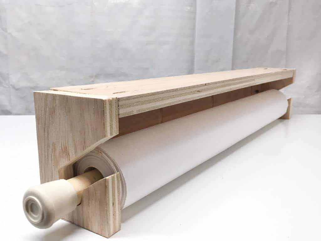 Test the fit of the paper roll in the holder before attaching it to the workbench.