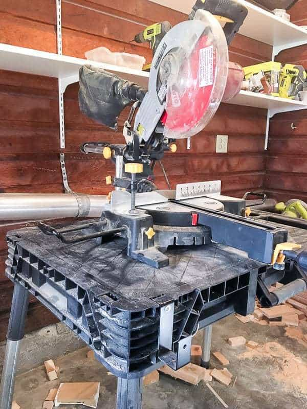 I need to build a new miter saw stand to replace this little worktable I'm currently using.