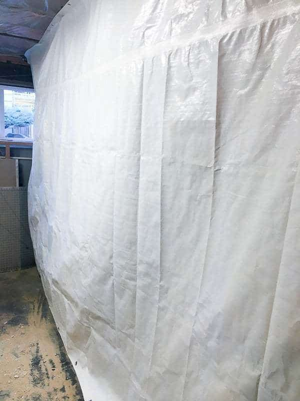 This white tarp protects all the other household stuff in the workshop from sawdust.