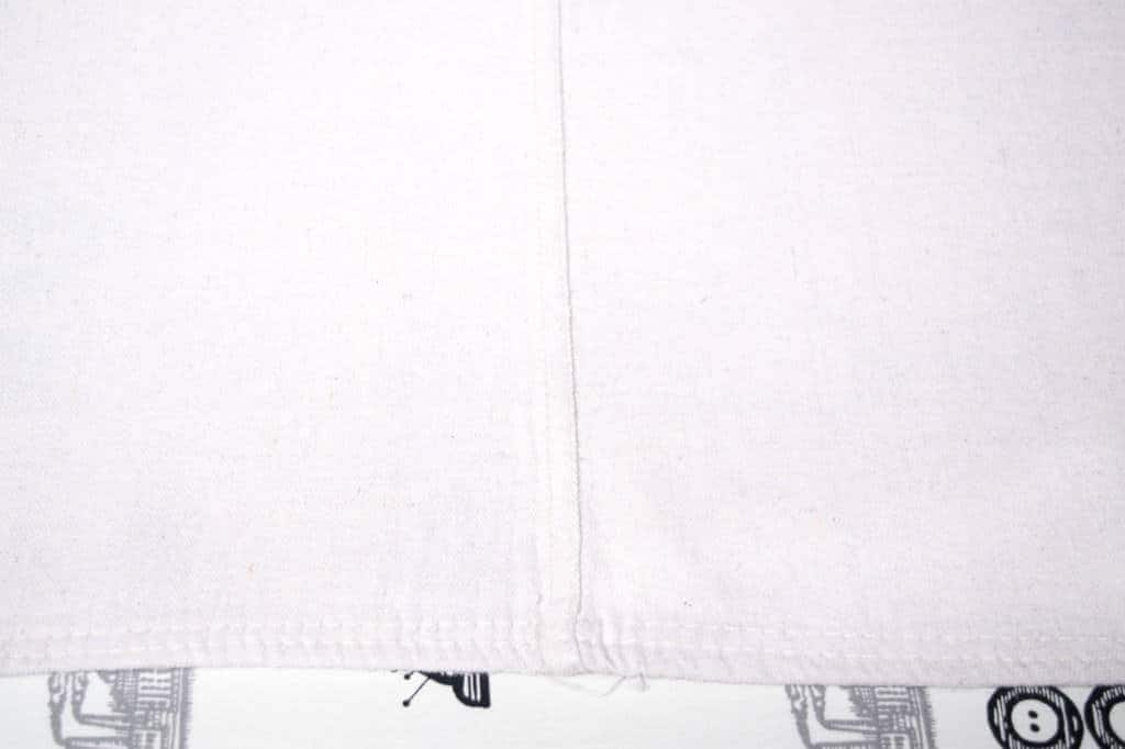 Use the seam line of the large drop cloth to create the hems of your drop cloth rug.