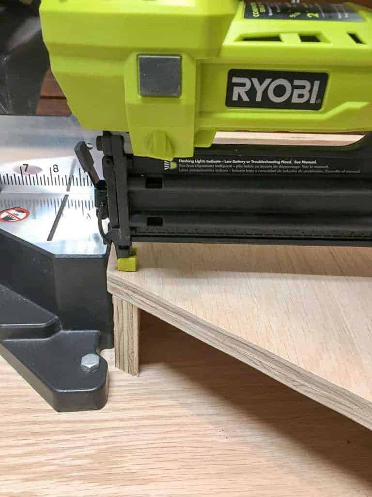 Attach the top of the miter saw supports.