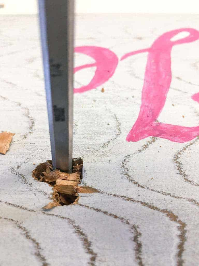 Use a chisel to form the rest of the heart on your Valentine's Day sign.