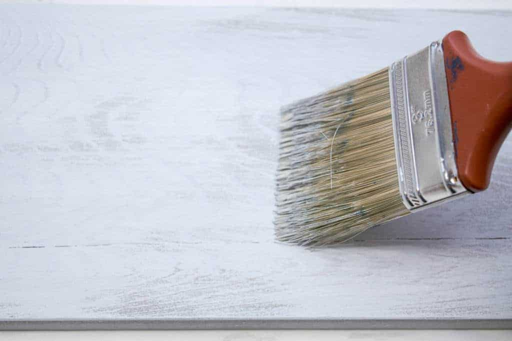 Applying a layer of light gray paint with a dry brush allows the grain to show through.