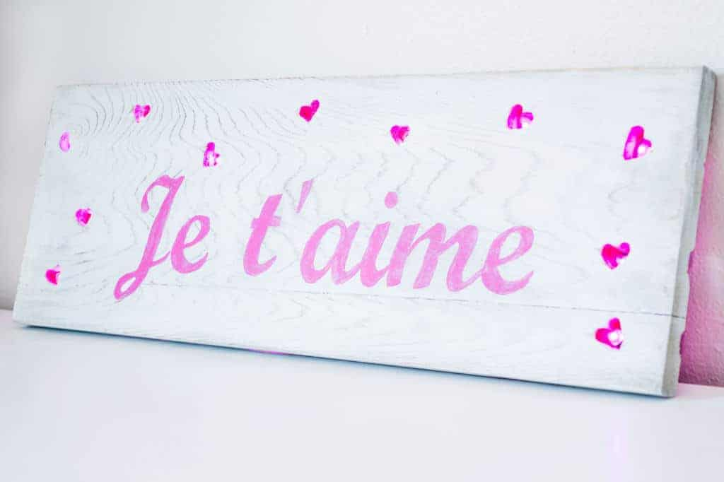 Light up your love with this Valentine's Day sign! Mini LED lights shine through heart shaped holes in the wood.