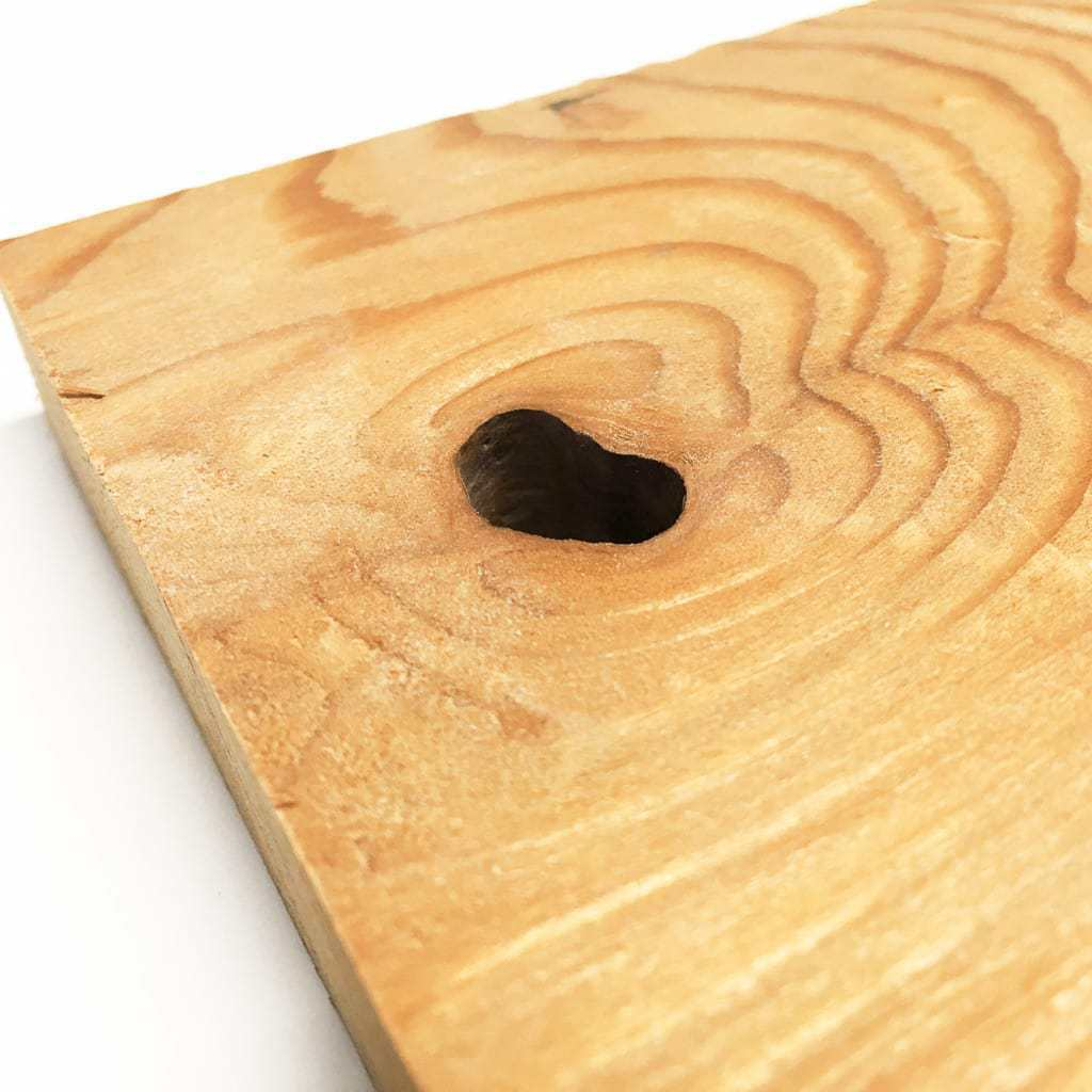 This heart shaped knot hole in a cedar board was the inspiration behind this Valentine's Day sign.