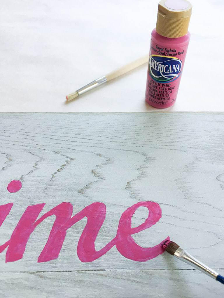 Following the indentations in the wood, fill in the letters of your Valentine's Day sign with bright pink paint.