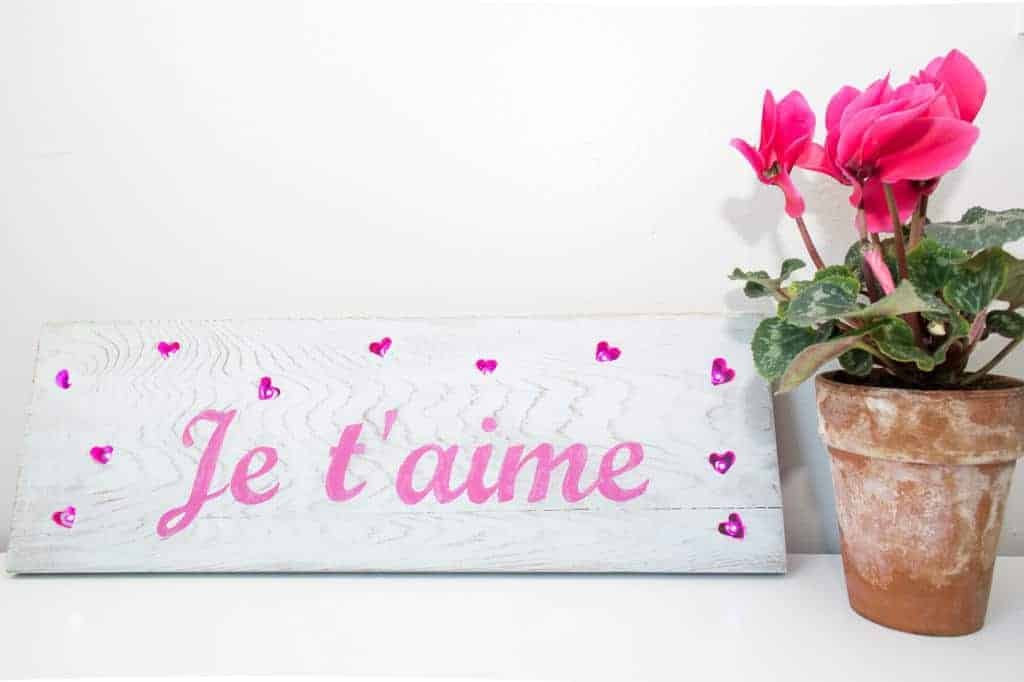Light up your love with this Valentine's Day sign! Mini LED lights are illuminated inside heart-shaped cutouts.