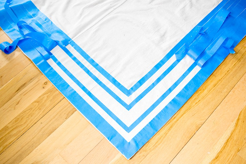 creating stripes on DIY rug with painter's tape