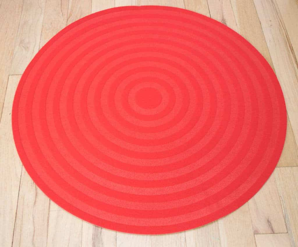 To paint a pokeball rug, start with a low pile red or white circle rug.