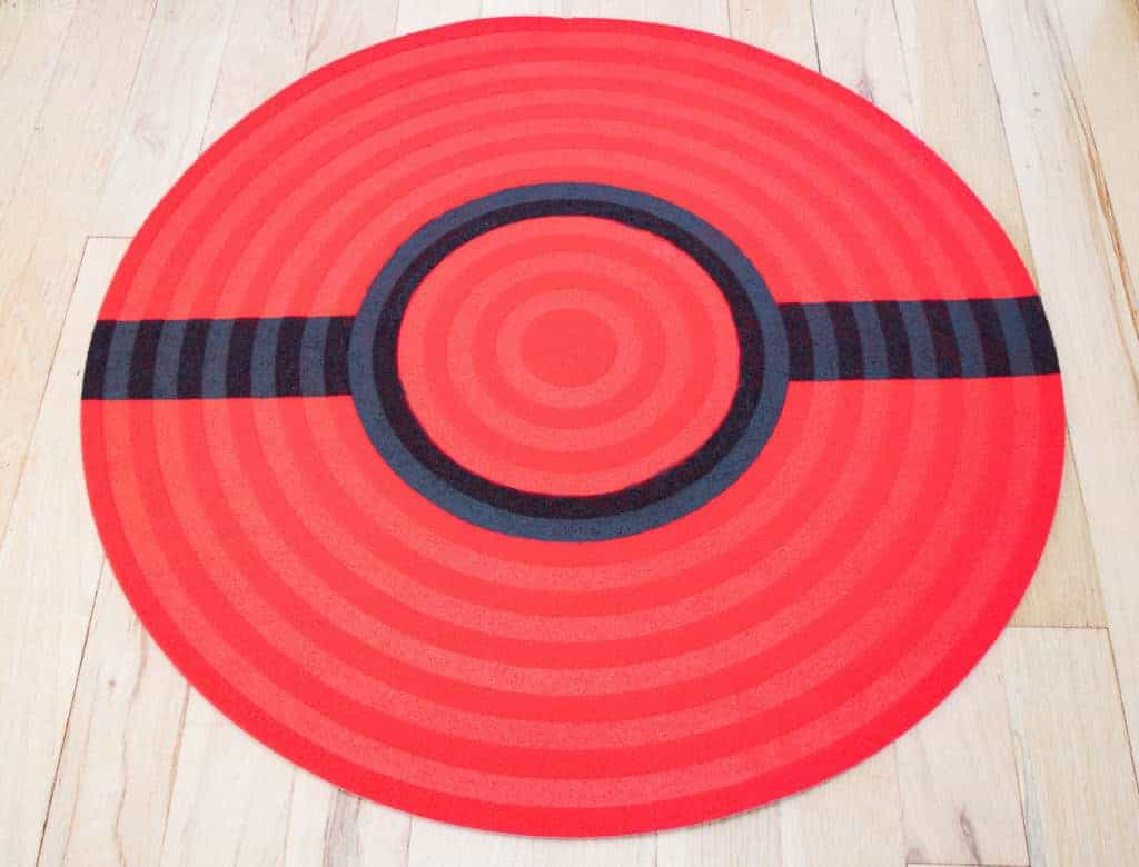 Black stripe of the pokeball rug painted.