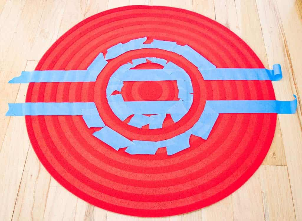 Tape off the black stripe for your pokeball rug.