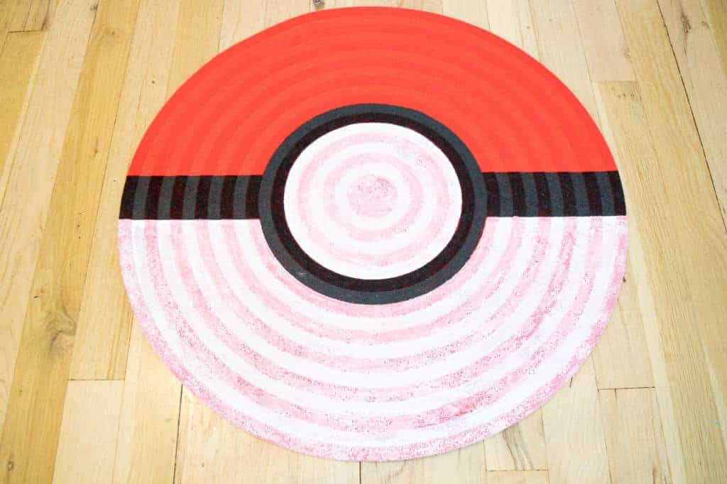 The first coat of white paint on the pokeball rug was still decidedly pink! It took two more coats to get it opaque.