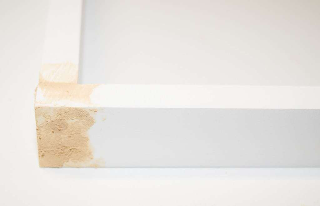 Use wood filler to cover up any gaps or holes for a seamless look on your poster frame.