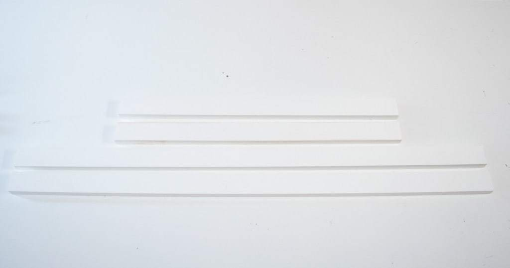 Cut two long and two short pieces to the dimensions specified for your poster frame.