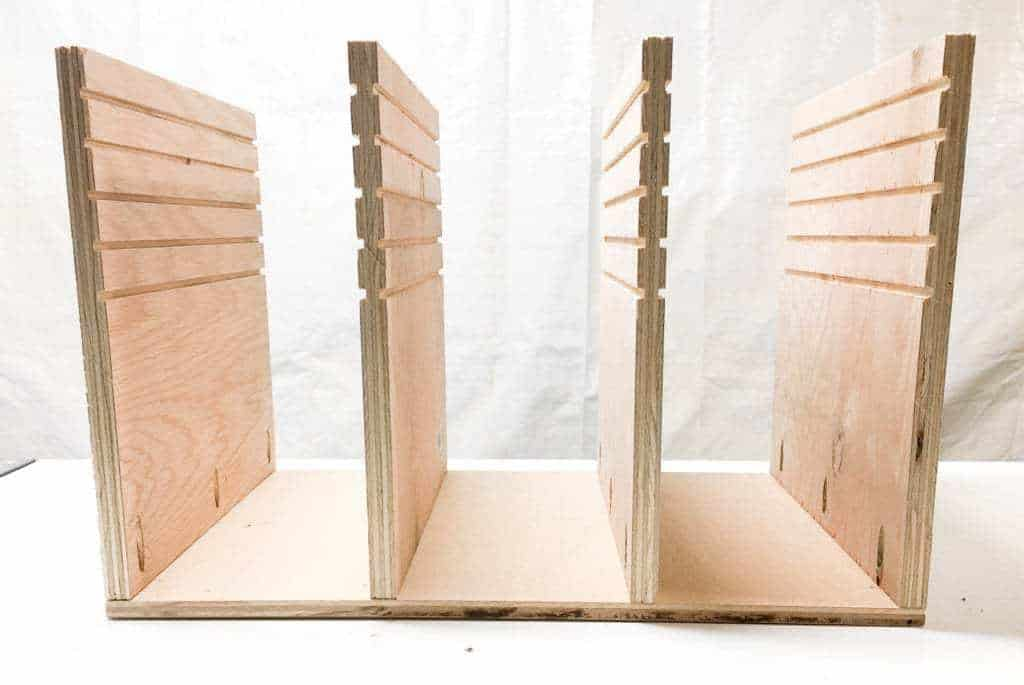 Attach the vertical supports to the bottom of your sander and sandpaper storage box with pocket hole screws.