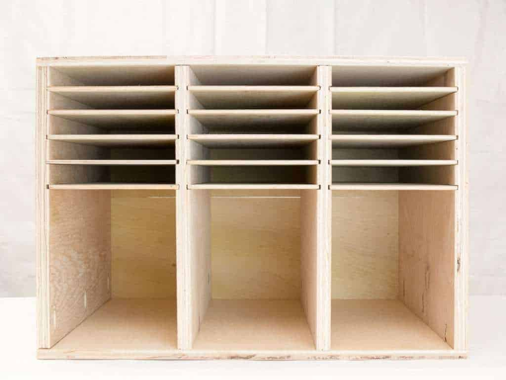 This sander and sandpaper storage is easy to make with scrap plywood, and houses three sanders and corresponding sandpaper. Free woodworking plans at The Handyman's Daughter!