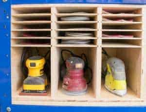 This triple sander and sandpaper storage piece fits perfectly on the lower shelf of my Kreg workbench! Get the free woodworking plans to make your own at The Handyman's Daughter!