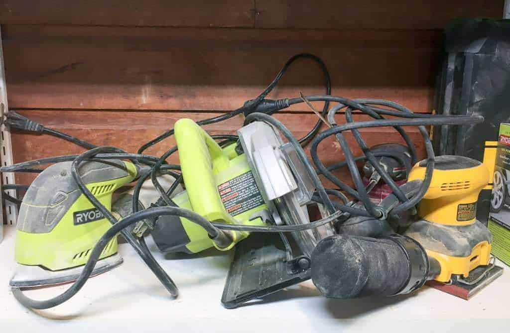 Before I built my sander and sandpaper storage unit, my sanders were a jumbled mess of cords!