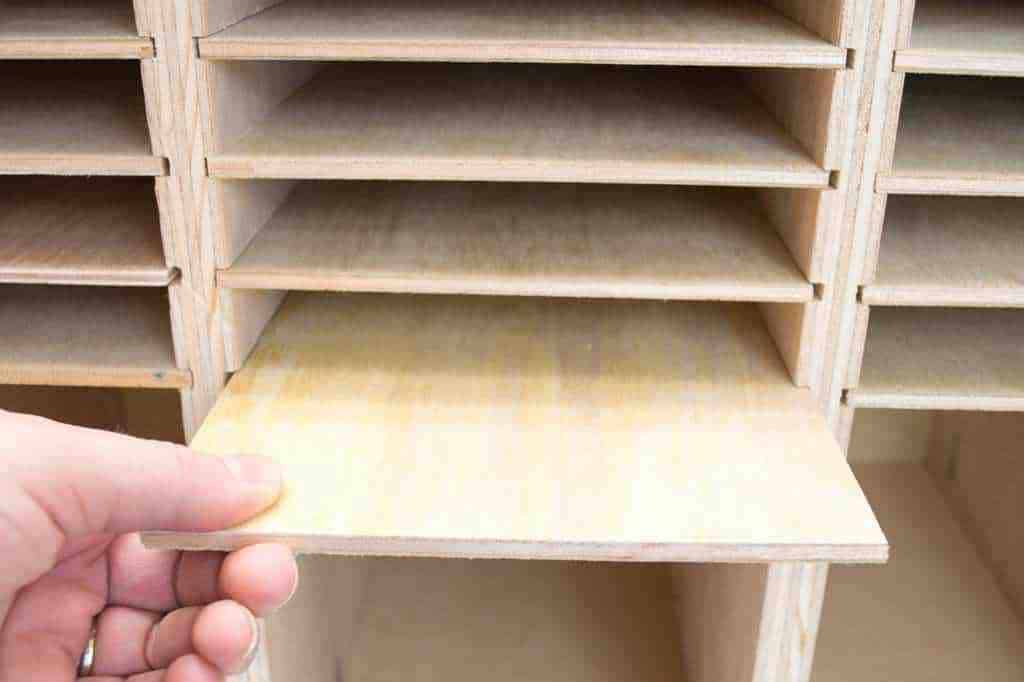 Slide the shelves in to make sandpaper storage above each sander.