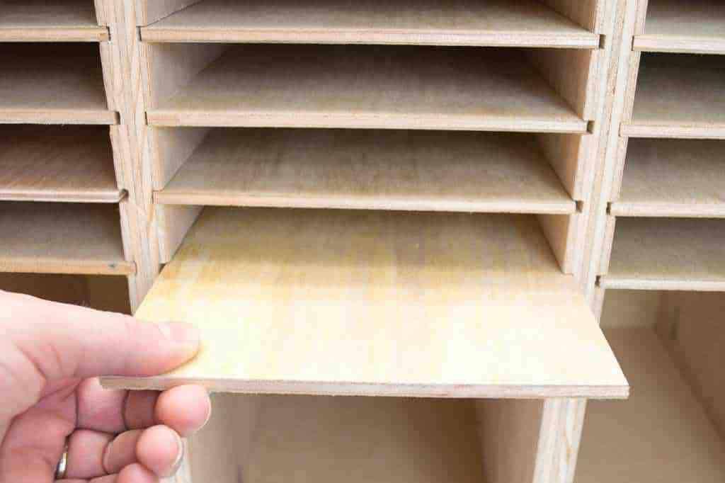 Slide the shelves in to make sandpaper storage above each sander.