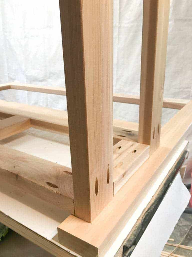 Attach the box for the storage bench to the back rest with pocket hole screws.